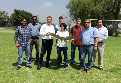 Learning about the use of UAV with CIMMYT scientists including (L-R) Francelino Rodrigues, Zia Ahmed, Martin Kropff, Lorena Gonzalez, Alex Park, Kai Sonder, Bruno Gérard and Juan Arista. (Photo: CIMMYT)