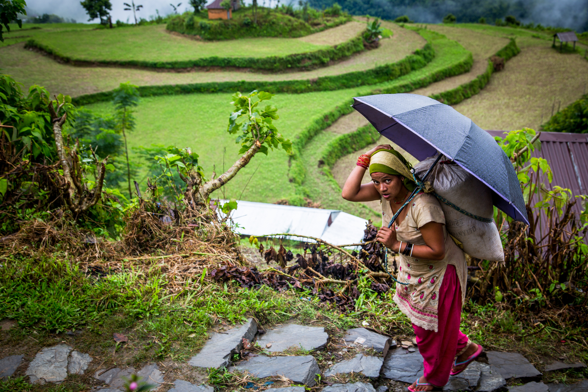 In the village of Nalma, Lamjung District, Nepal, most of the adult male population has gone abroad for work, leaving only children, women and the elderly. (Photo: Mokhamad Edliadi/CIFOR)