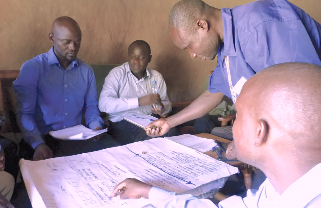 Men in Kenya participate in a focus group discussion as part of GENNOVATE's field research (Photo: Renee Bullock/IITA)