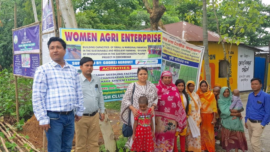 Hosneara Bibi (center, in pink) poses for a photograph with other members of her self-help group, SSCOP representatives and Sagarika Bose, Deputy General Manager of Corporate Social Responsibility for Godrej Agrovet. (Photo: SSCOP)