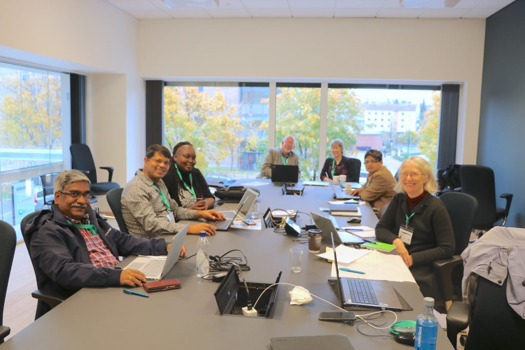 Tek Sapkota (second from left) and other scientists participate in a small group session during a meeting of lead authors of the Intergovernmental Panel on Climate Change (IPCC).