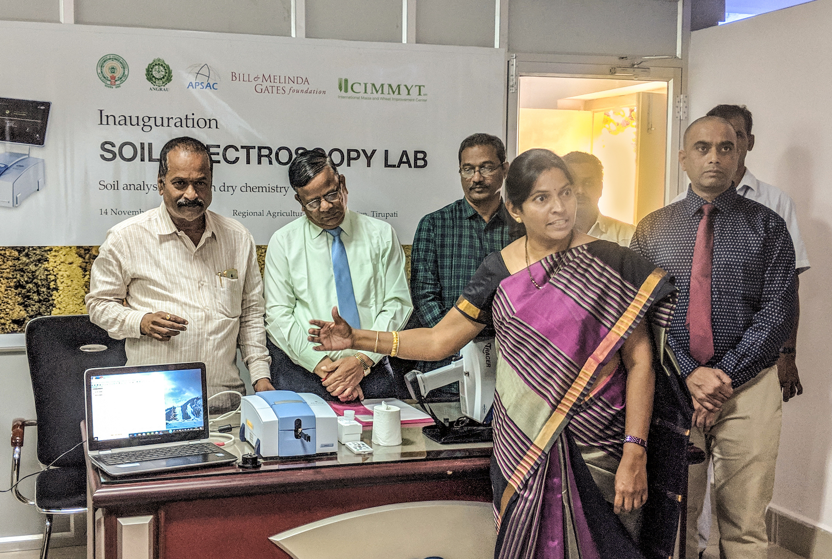 K.V. Naga Madhuri, Principal Scientist for Soil Science at Acharya N. G. Ranga Agricultural University (front), explains soil spectra during the opening of the soil spectroscopy lab at the Regional Agricultural Research Station in Tirupati, Andhra Pradesh.