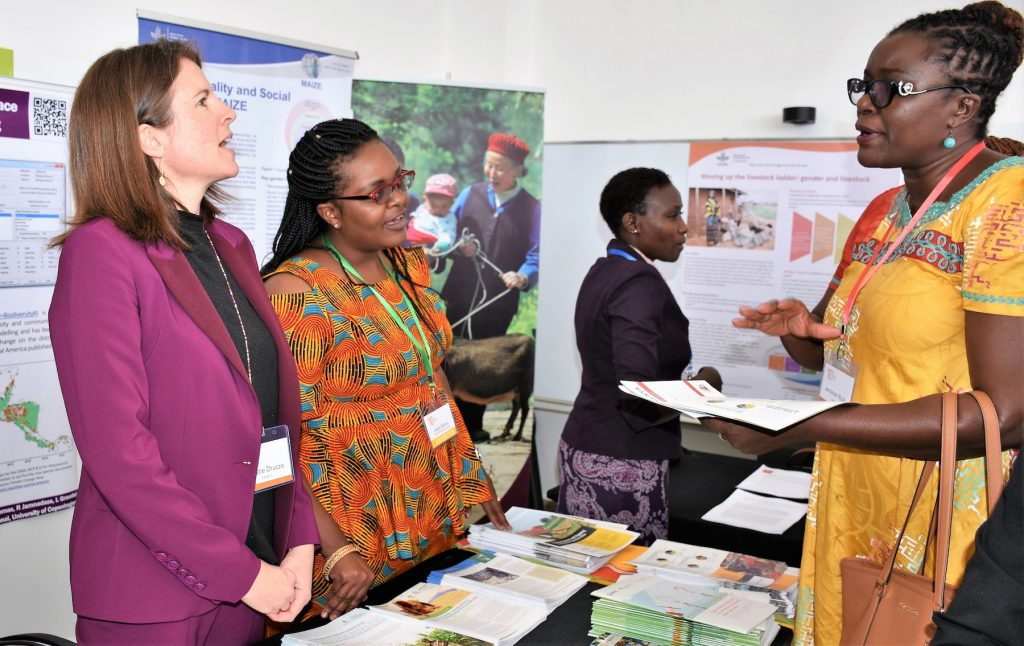CIMMYT researchers Kristie Drucza (left) and Rahma Adam (second from left) showcased CIMMYT's gender work at AWARD's tenth anniversary event in Nairobi. (Photo: Joshua Masinde/CIMMYT)