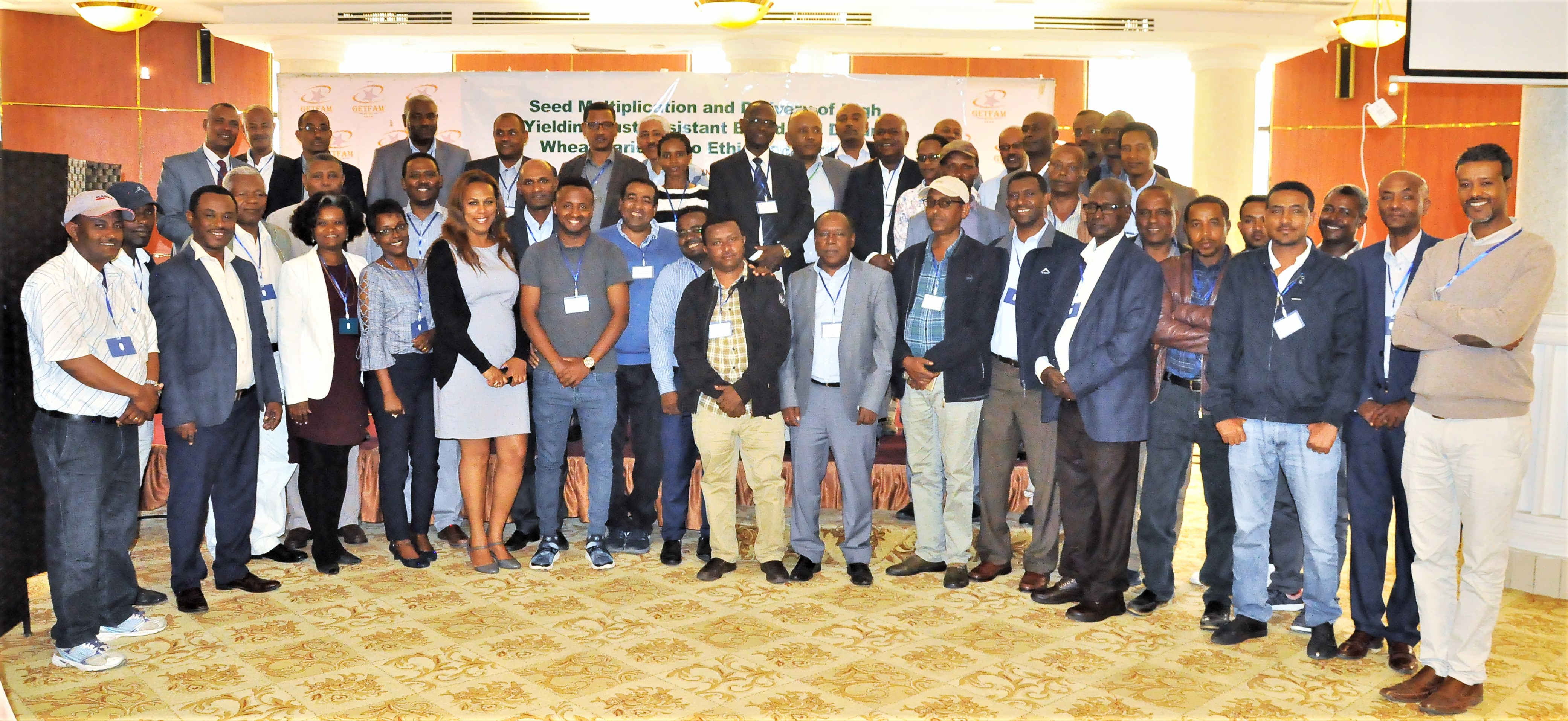 Participants of the project closure workshop stand for a group photo. (Photo: Semu Yemane/EIAR)