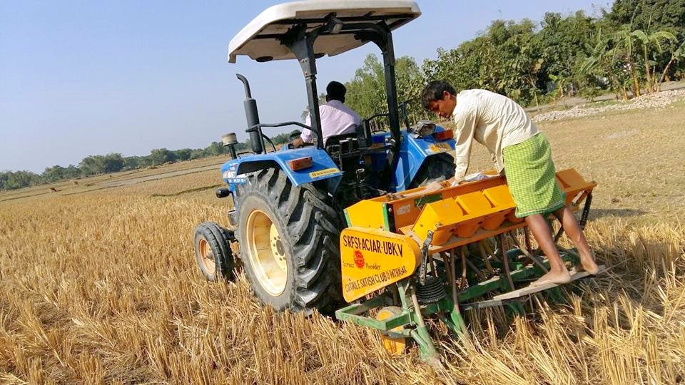 A zero-tillage multi-crop planter at work in West Bengal.