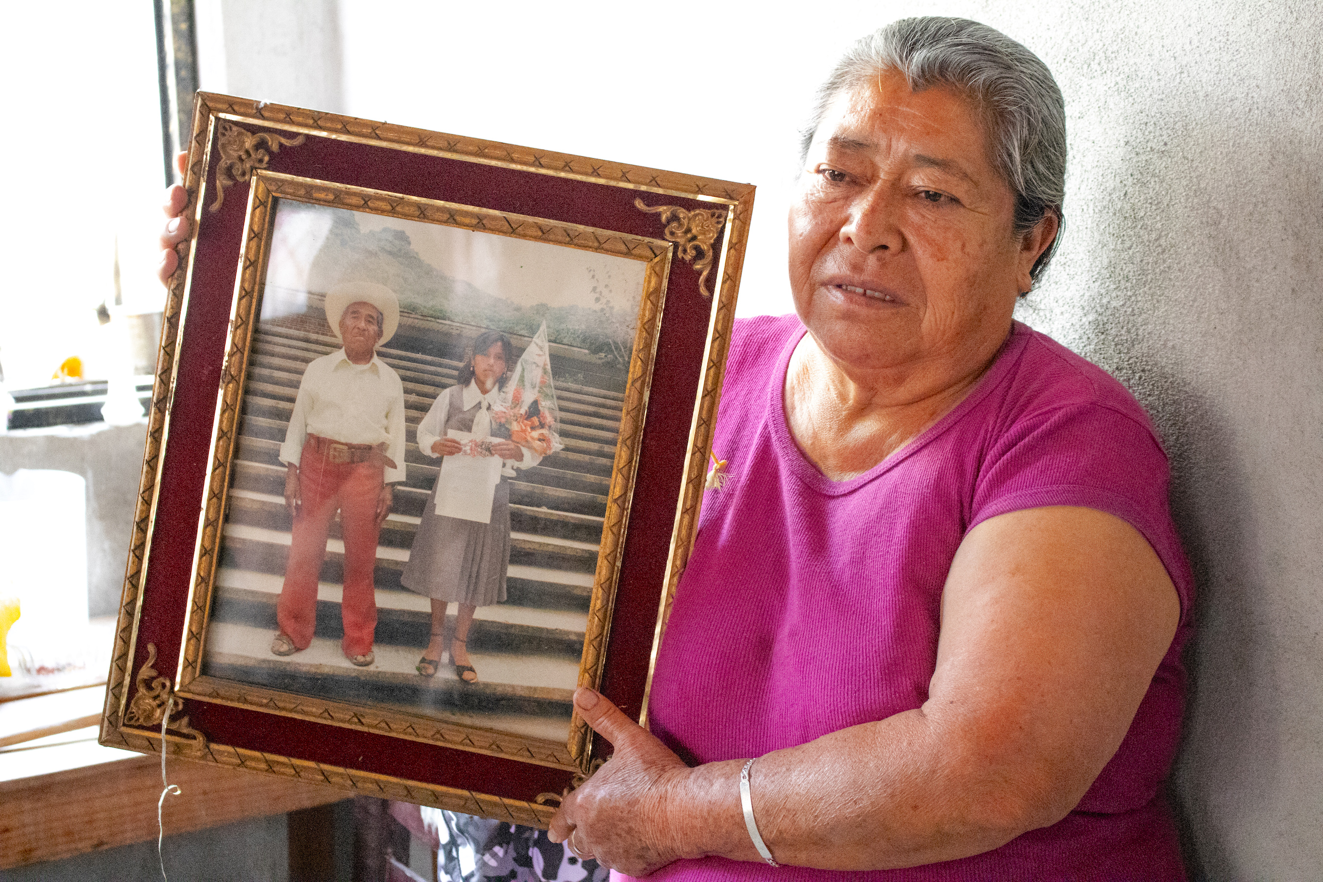 Ventura Oliveros Garcia holds a photograph of her father, Santos Oliveros, who was one of the maize farmers who donated seed to CIMMYT's genebank in 1966-67. (Photo: E. Orchardson/CIMMYT)