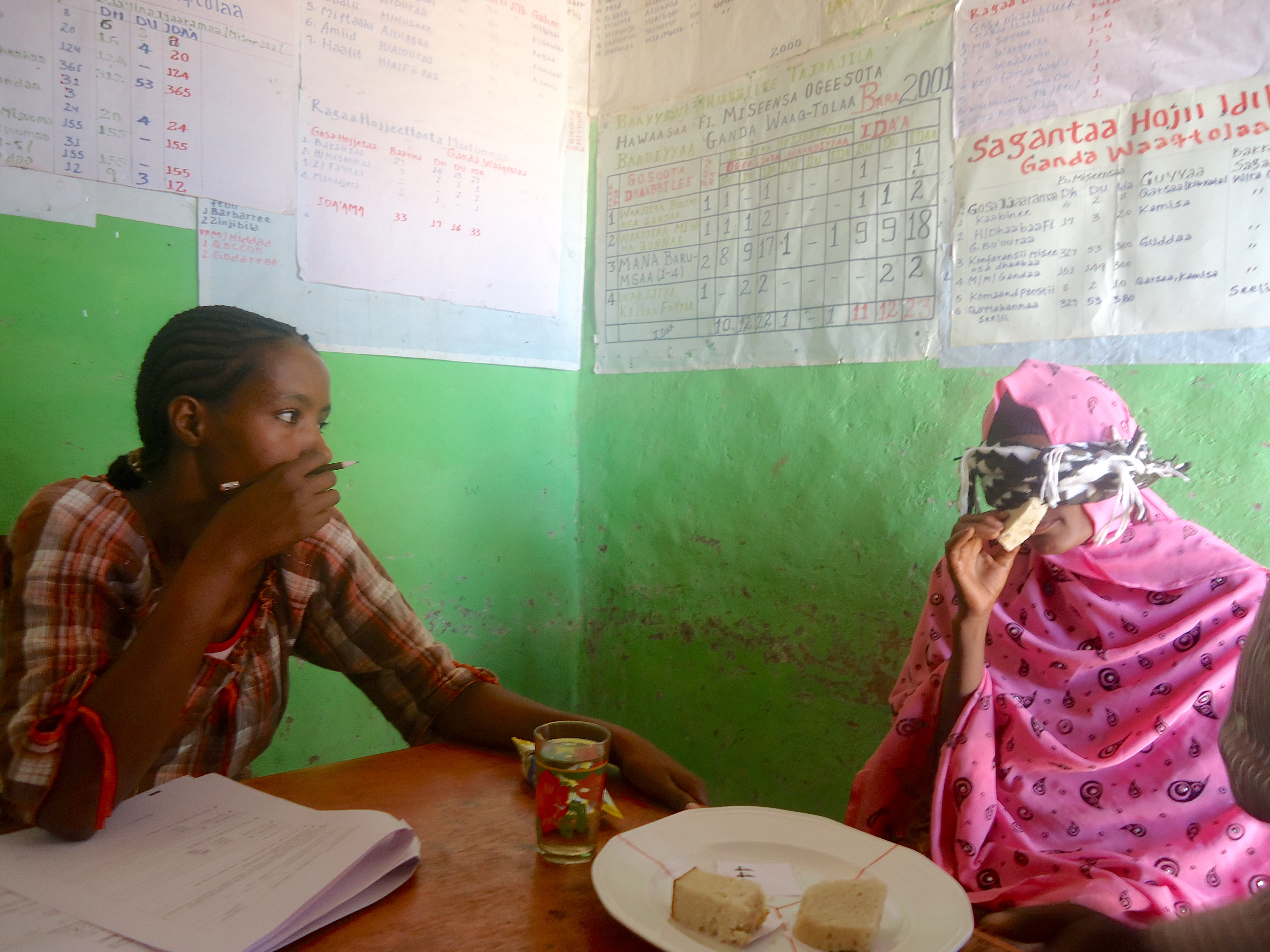A woman in Jimma, Oromia region, participates in a blind tasting of QPM maize products. (Photo: Samuel Diro/CIMMYT)