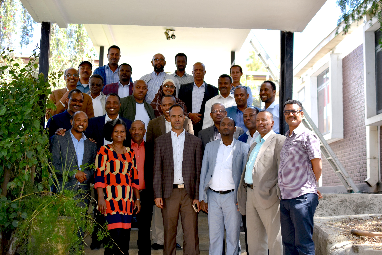 Workshop participants pose for a group photograph.