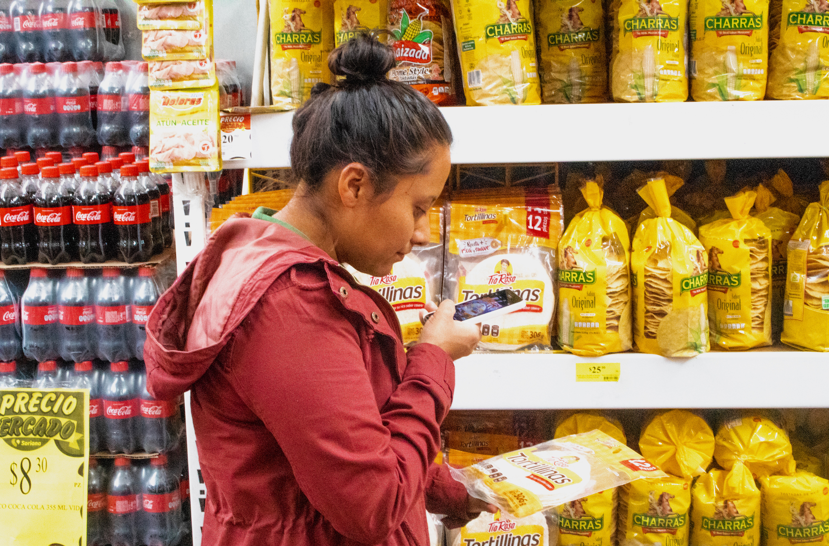 A researcher captures nutritional information from a packet of tortillas. (Photo: Emma Orchardson/CIMMYT)