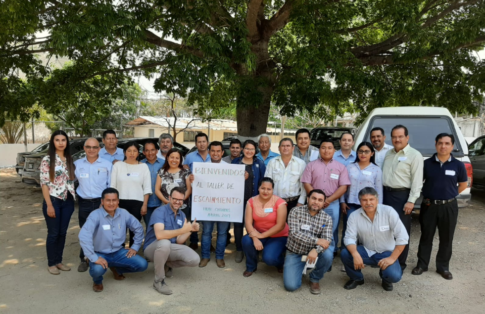 Participants in the scaling workshop stand for a group photo with the trainers. (Photo: CIMMYT)