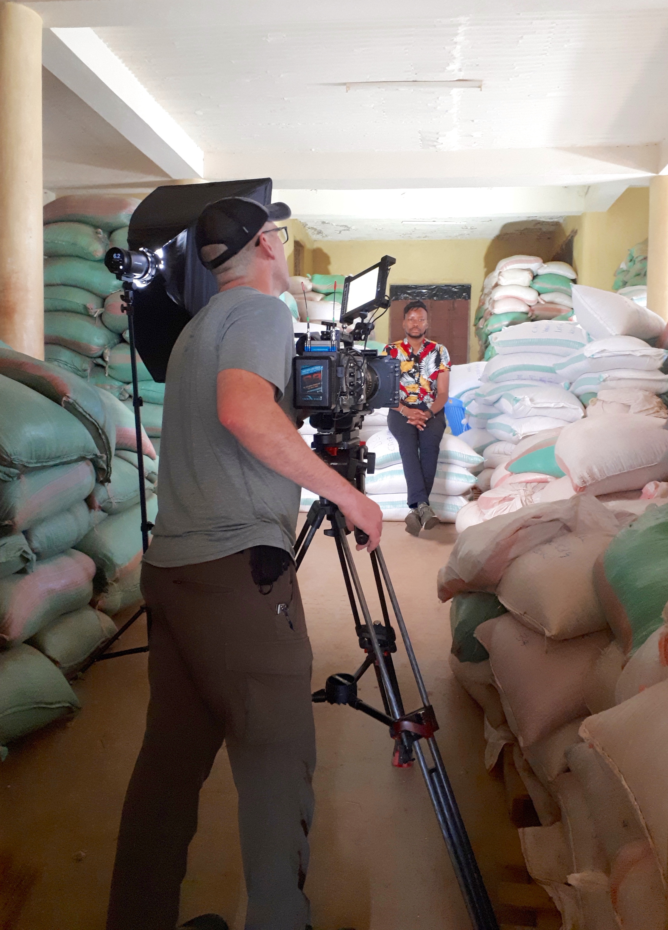 The video crew films and interview in a seed storage room. (Photo: Jerome Bossuet/CIMMYT)
