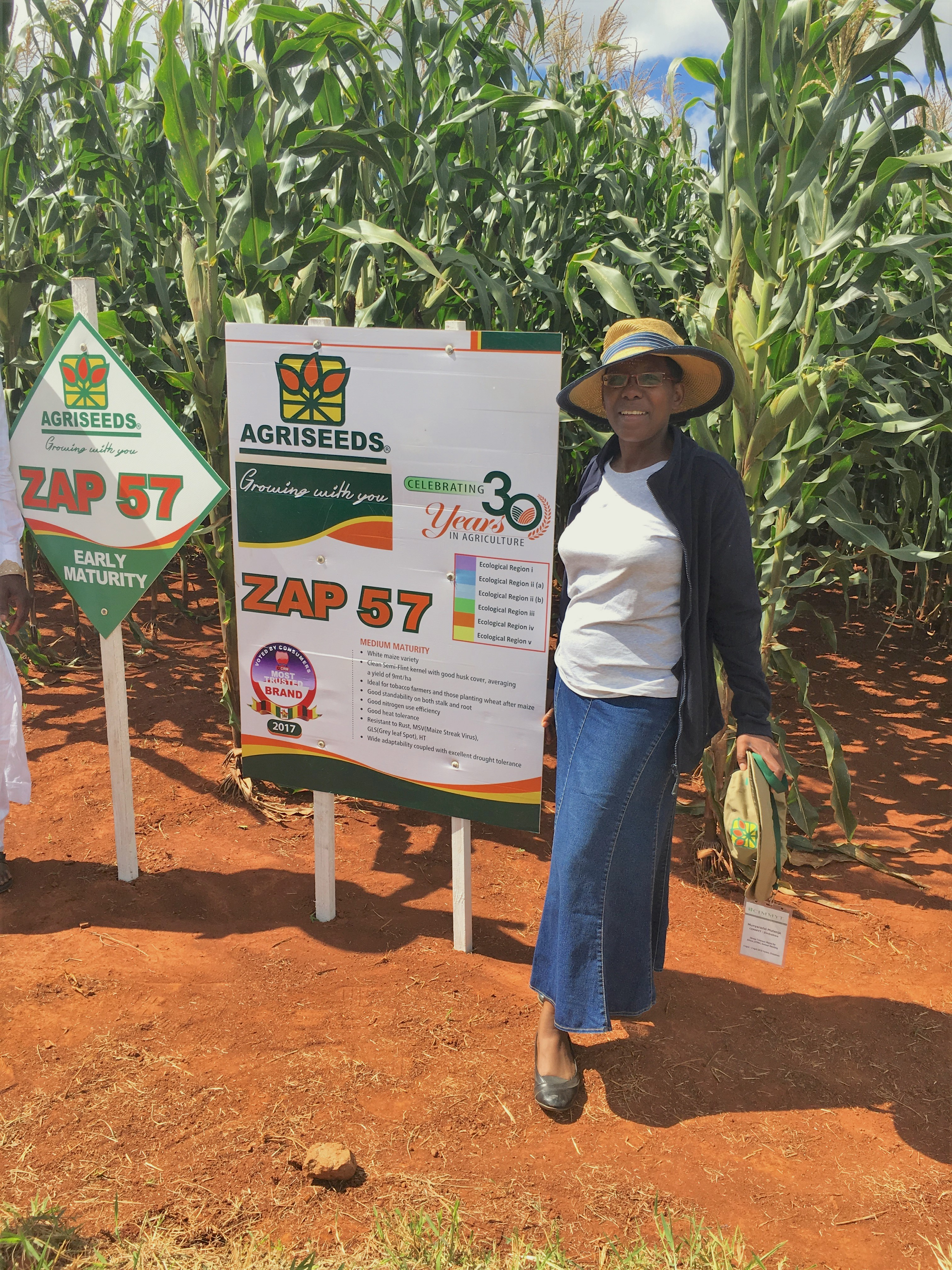 Mutenje stands next to a demonstration plot of maize during a field day organized by CIMMYT and Agriseeds. (Photo: CIMMYT)