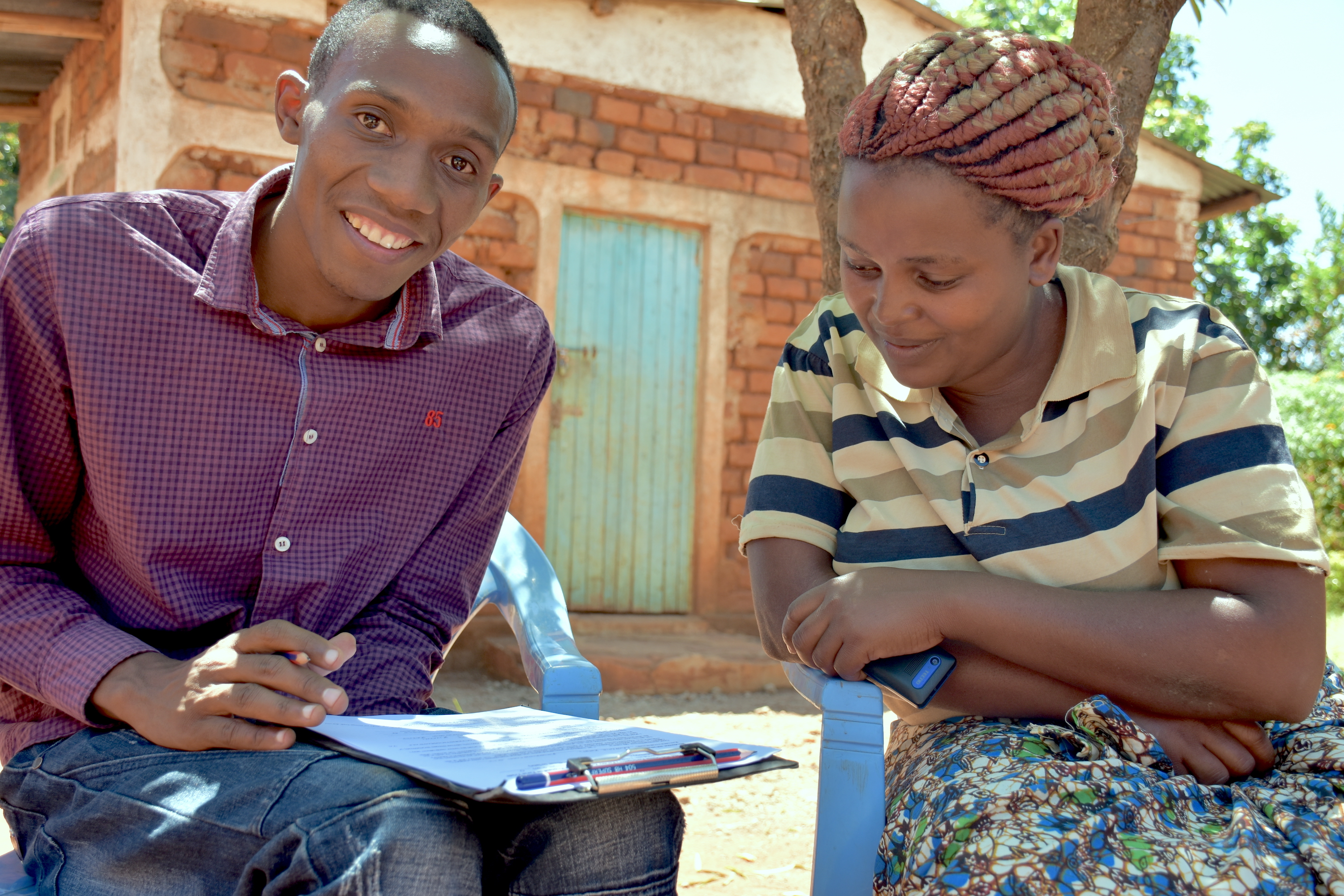 An enumerator (left) collects a farmer's details and socioeconomic data before she participates in the evaluation of maize varieties. (Photo: Joshua Masinde/CIMMYT)