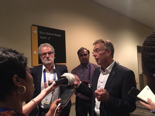Martin Kropff (right), Director General of the International Maize and Wheat Improvement Center (CIMMYT), speaks to the press at the International Wheat Congress. (Photo: Marcia MacNeil/CIMMYT)