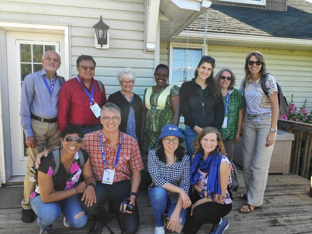 WHEAT-sponsored journalists stand for a group photo with farmer Merle Rugg (top row, third from left), in Elstow, Saskatchewan. (Photo: Amit Bhattacharya)