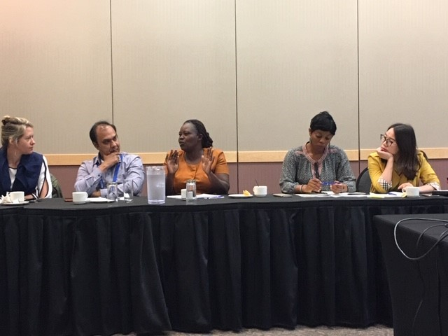 Lominda Afedraru (center) from Uganda's Daily Monitor shares her experience covering science with participants at the journalist roundtable. (Photo: Marcia MacNeil/CIMMYT)