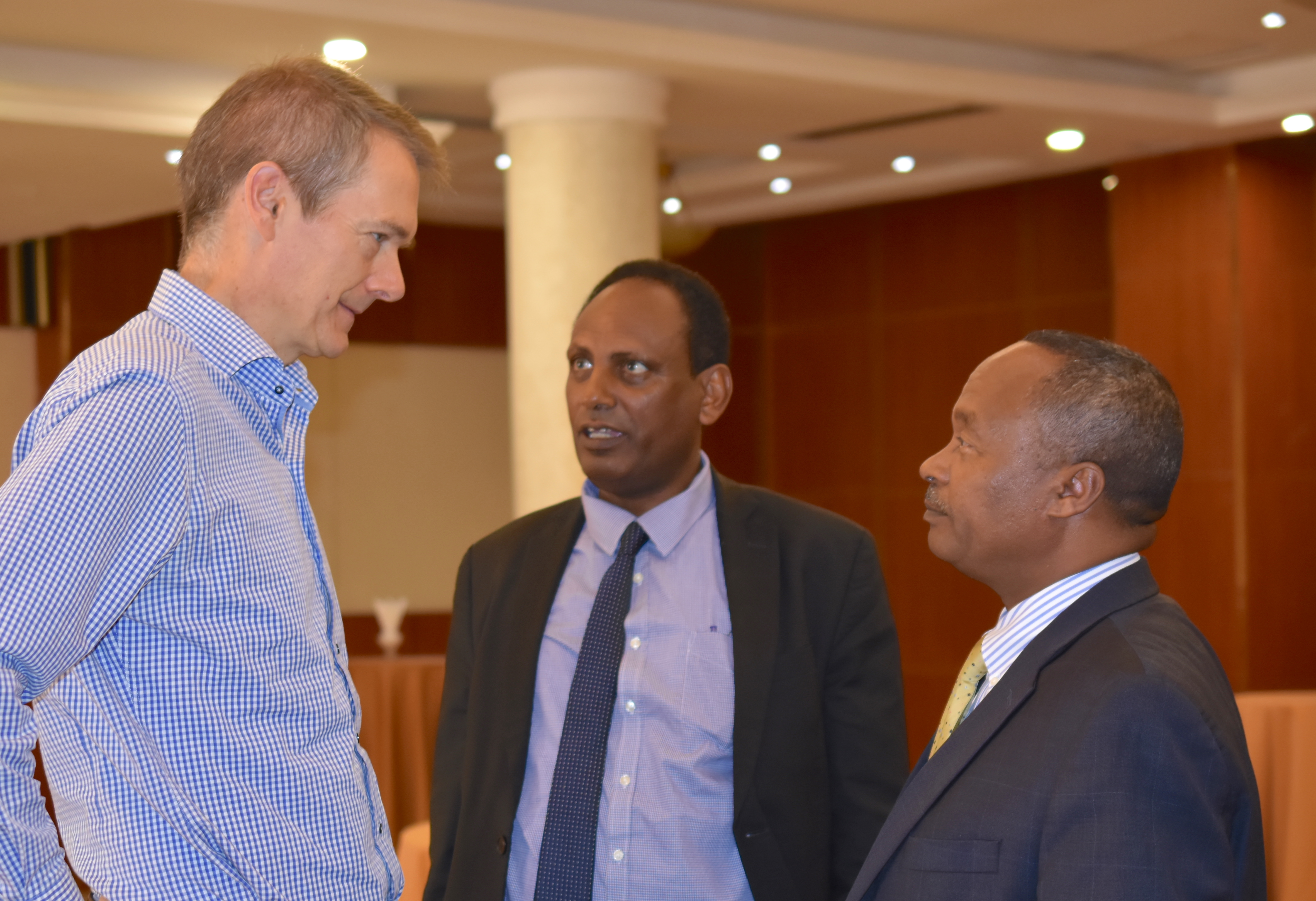 CIMMYT's Socioeconomics Program Director, Olaf Erenstein (left), talks to Eyasu Abraha, Minister of Agriculture and Natural Resources (center), and Mandefro Nigussie, Director General of the Ethiopian Institute of Agricultural Research.