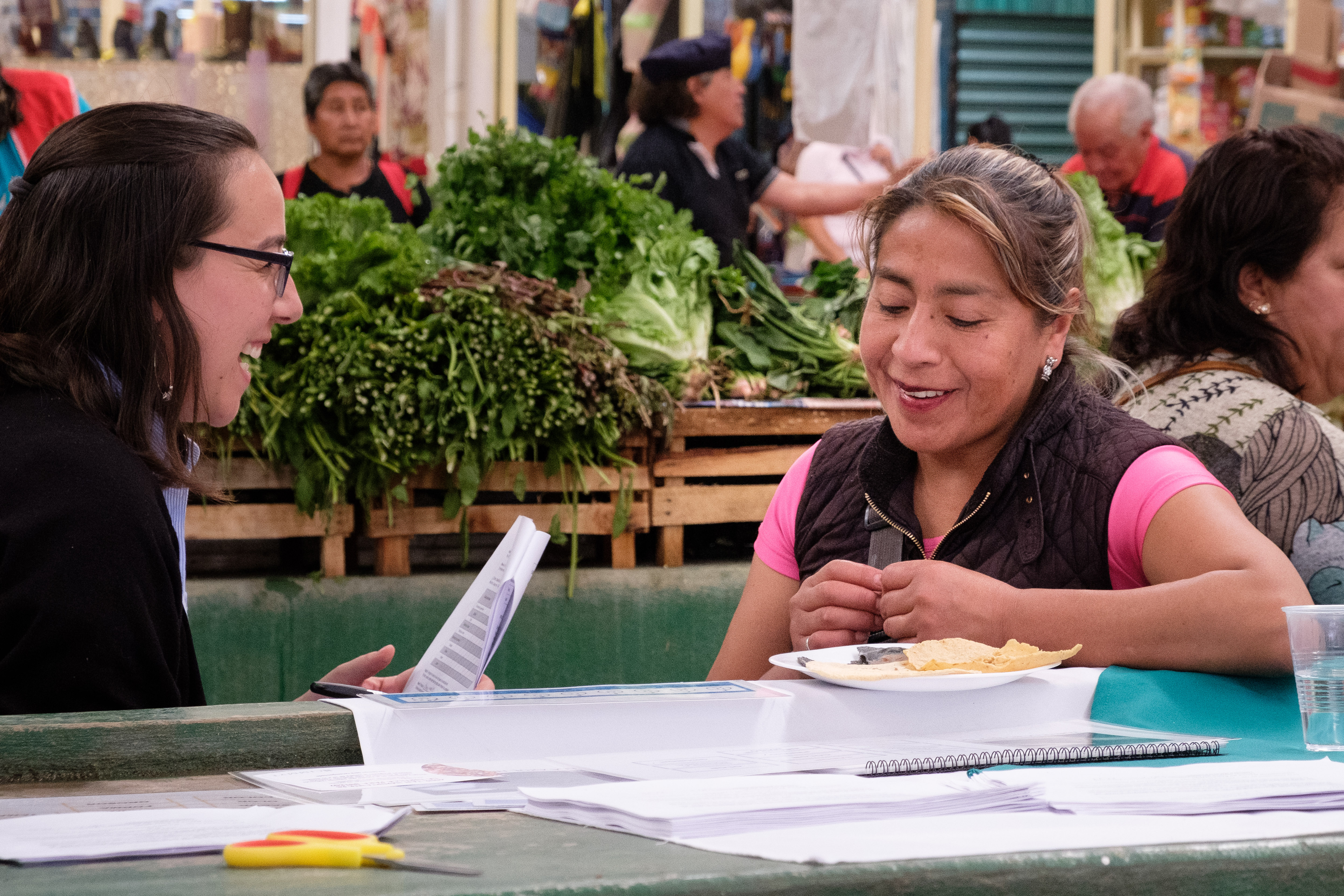 """As a Colombian, it really surprised me that Mexicans were able to distinguish between white and blue maize tortillas even when blindfolded! It really shows the importance of maize to their diet and culture,"" said Diana Ospina Rojas (left), research assistant and interviewer. (Photo: Carolyn Cowan/CIMMYT)"