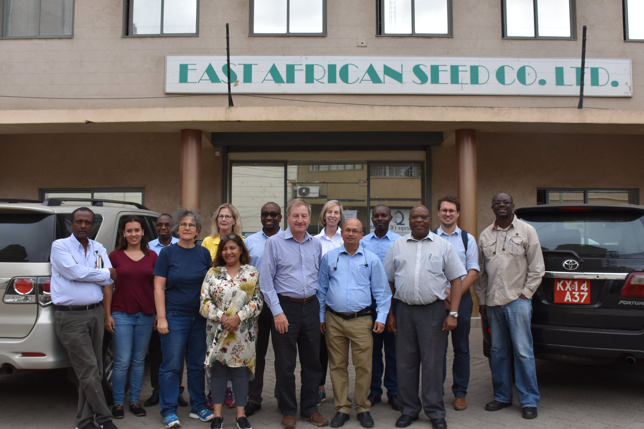 CIMMYT board members and staff stand for a group photo outside the offices of East African Seed. (Photo: Jerome Bossuet/CIMMYT)