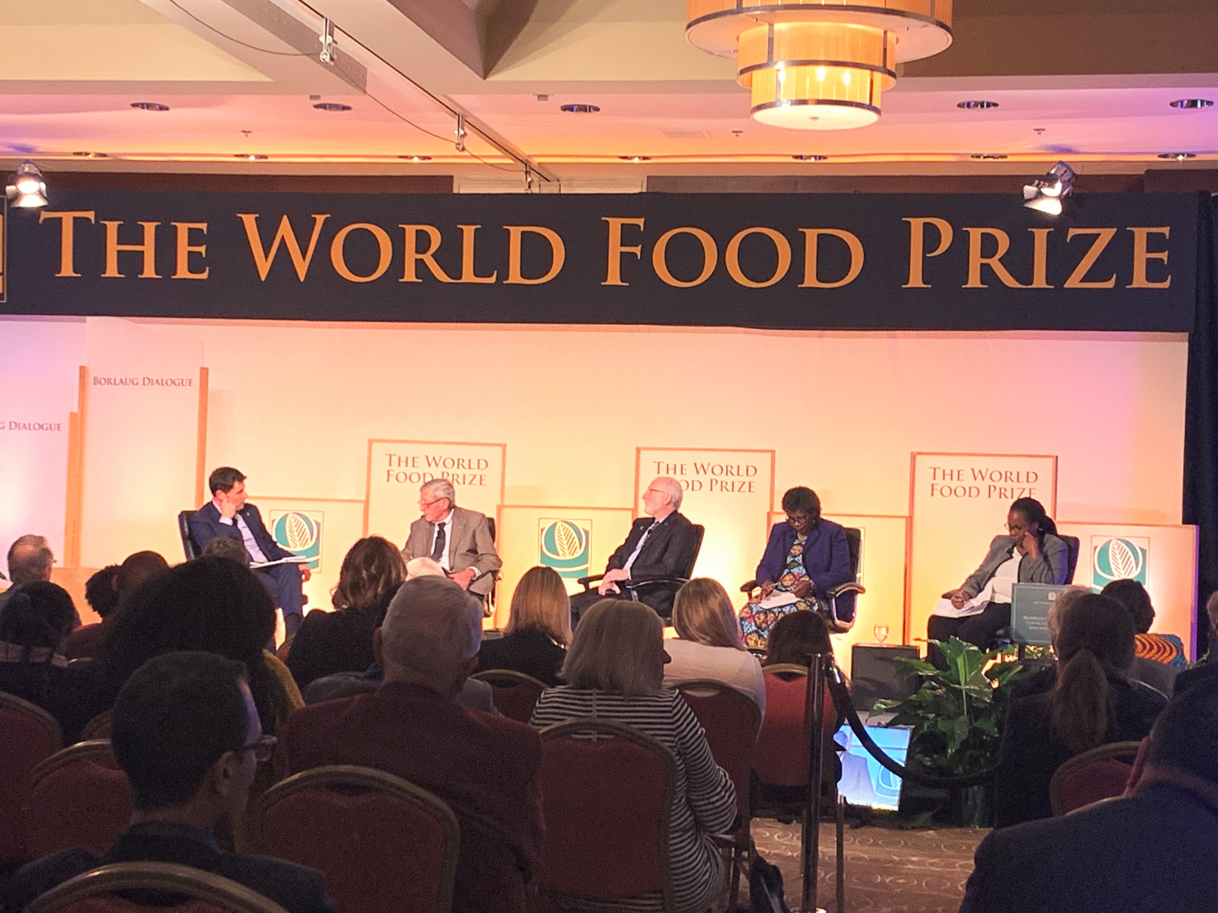 The Executive Director of CGIAR, Elwyn Grainger-Jones (left), 2019 World Food Prize Laureate, Simon Groot (second from left) and other speakers present CGIAR's Crops to End Hunger initiative. (Photo: Mary Donovan/CIMMYT)