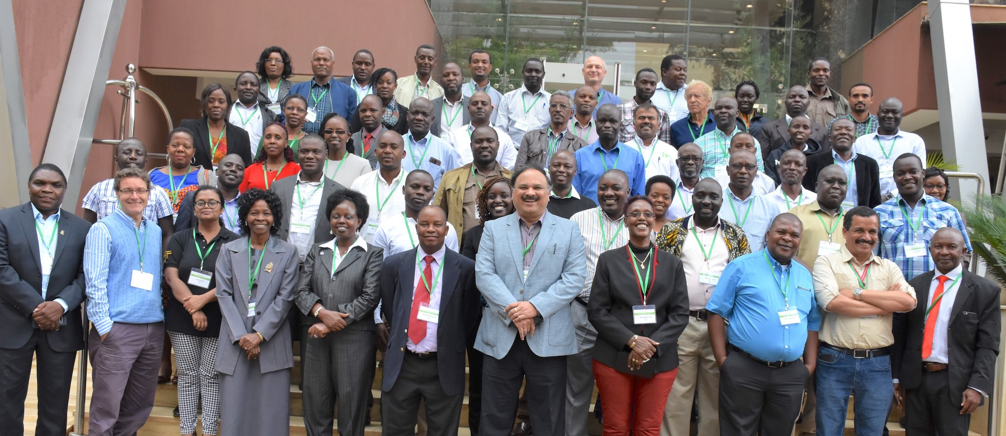 Participants at the MLN projects closure workshop stand for a group photo. (Photo: Joshua Masinde/CIMMYT)