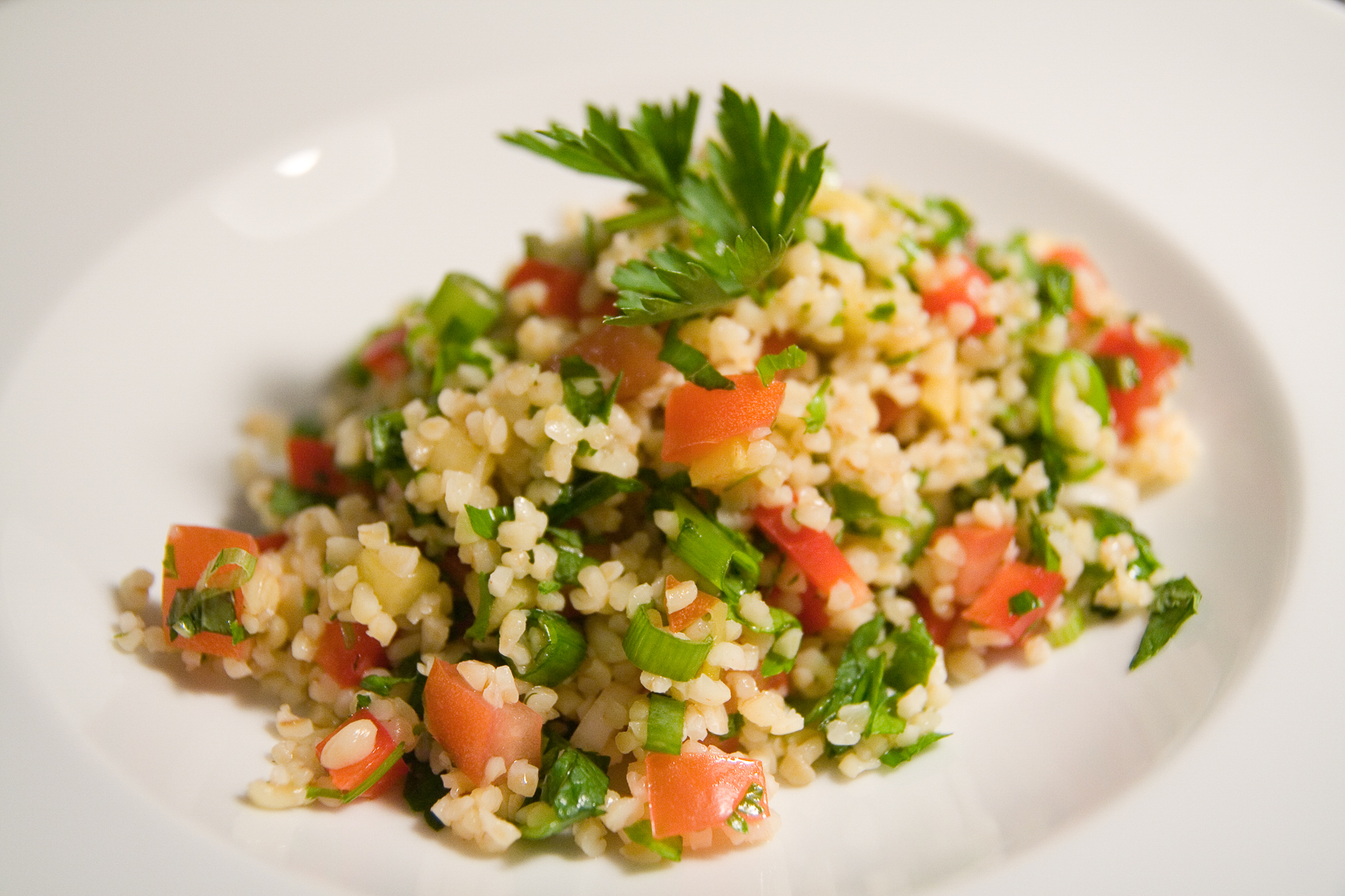 Tabbouleh, a Levantine salad made with a base of soaked bulgur wheat. (Photo: Moritz Guth)