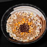 A basket contains an assortment of whole, unprocessed maize and wheat kernels. (Photo: Alfonso Cortes/CIMMYT)