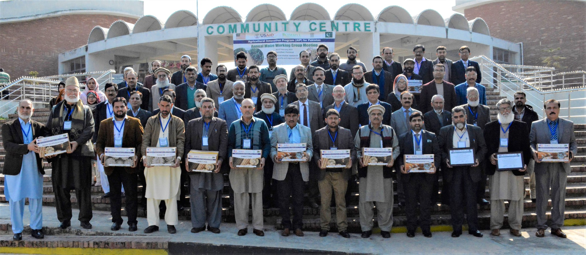 Participants at a February 2020 maize working group meeting of the Pakistan Agricultural Innovation Program (AIP) with seed of maize parental lines shared by CIMMYT. (Photo: Awais Yaqub)