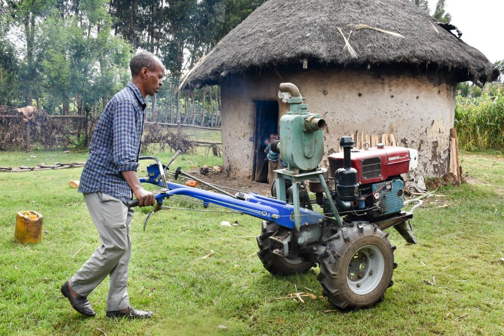 Temam Mama drives a two-wheel tractor to the irrigation area. (Photo: Simret Yasabu/CIMMYT)