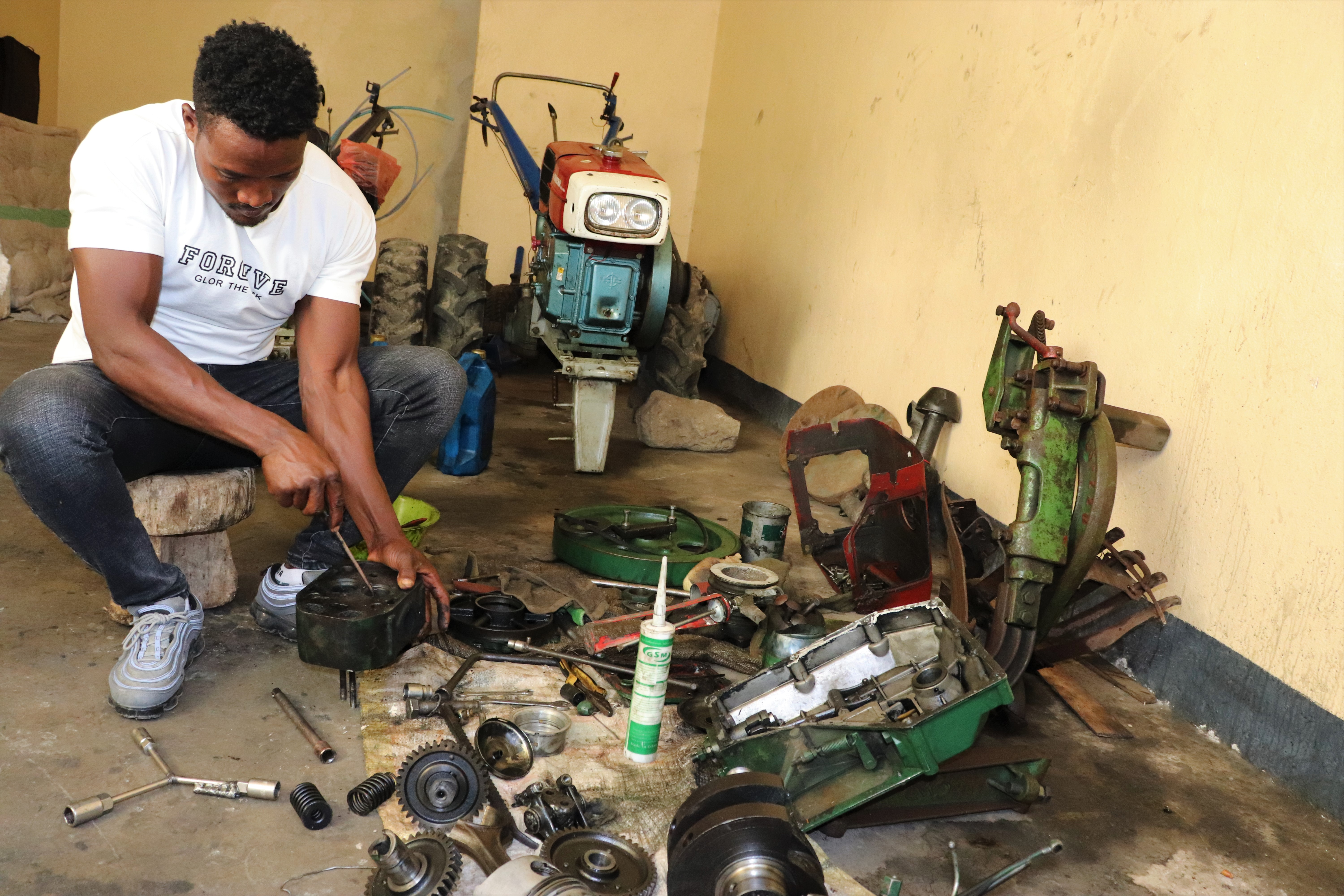 Beyene Chufamo (28) is a two-wheel tractor technology service provider based in Meki, Ethiopia. In 2016, with the support of CIMMYT, he started providing repair and maintenance services to service providers in different areas. (Photo: Ephrem Tadesse/CIMMYT)