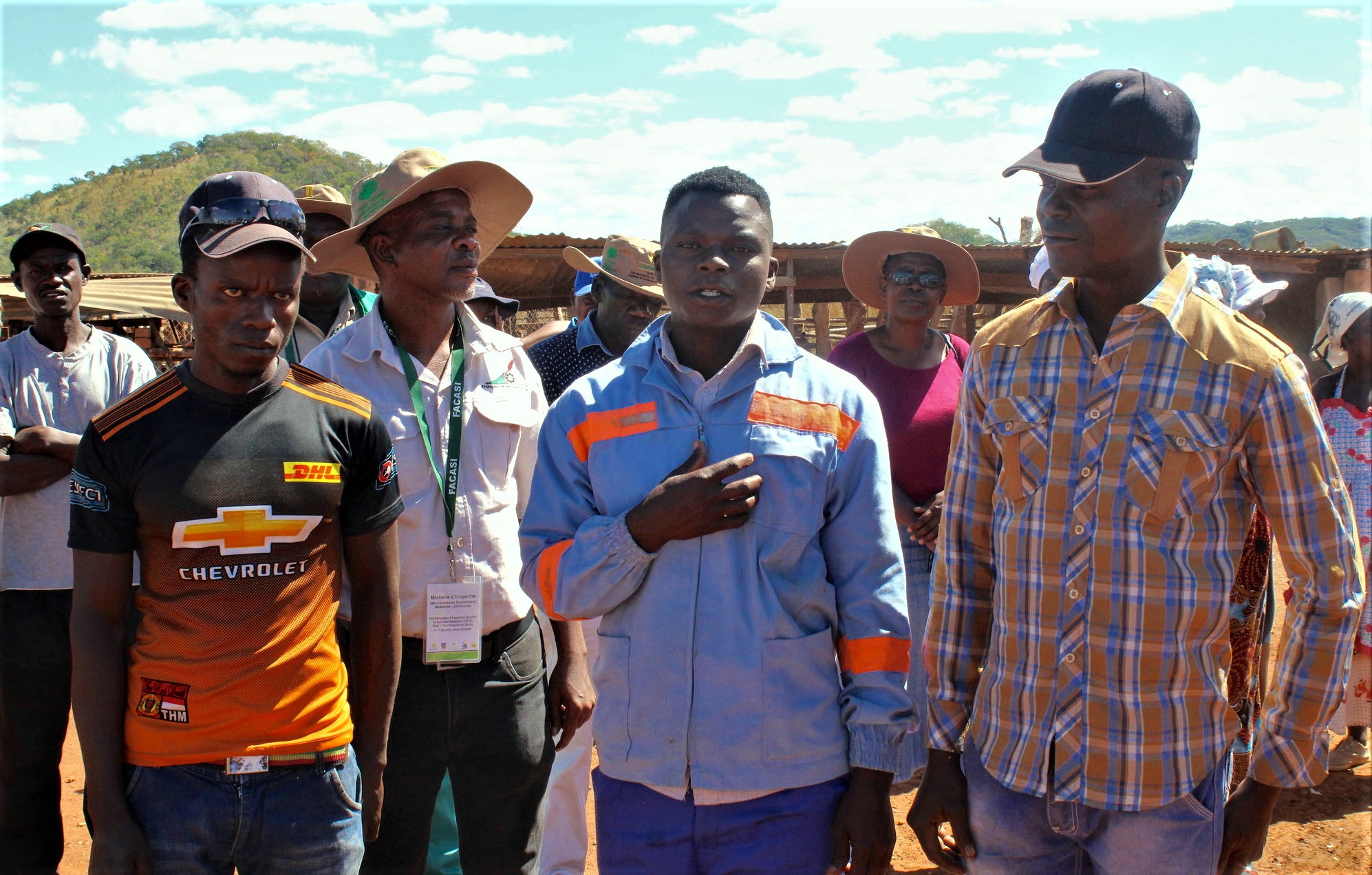 Targeting youth in interventions such as the Farm Mechanization and Conservation Agriculture for Sustainable Intensification (FACASI) project provides pathways for training in appropriate mechanized solutions to support farmers in rural areas. The enterprising Mwanga Youth Group members Pinnot Karwizi (28), Shepherd Karwizi (26) and Masimba Mawire (32) provide grain shelling services to farmers in Makonde District, Zimbabwe. (Photo: Shiela Chikulo/CIMMYT)