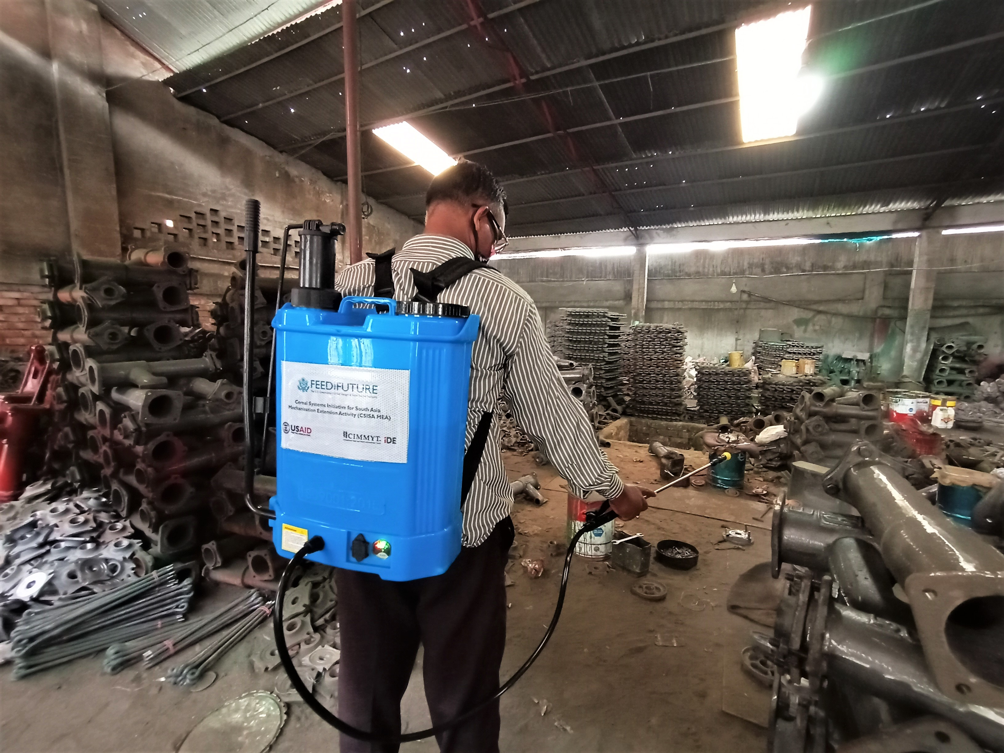 Man disinfects machines.