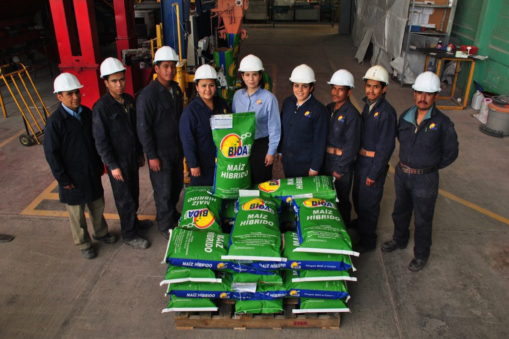 Bidasem director general María Ester Rivas (center) stands for a photo with her seed processing team. Bidasem is a small seed company based in the city of Celaya in the central Mexican plains region known as the Bajío. Despite their small size, Bidasem and similar companies play an important role in reaching small farmers with improved seed that offers them better livelihoods. (Photo: X. Fonseca/CIMMYT)