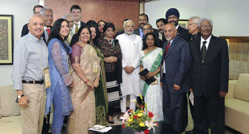 Dr. Sanjaya Rajaram is pictured on the far right, with Prime Minister Mr. Narendra Modi in the center of photo.