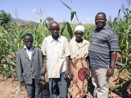 IIAM researcher David Mariote (right) with farmers of Manica Province, Mozambique.