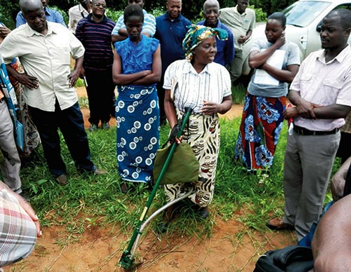 Transforming agriculture through technology: One of the farmers in Mitundu district, Malawi, Mrs Grace Chitanje, leads in demonstrating the use of Li seeder equipment. Photo by Jefias Mataruse/CIMMYT