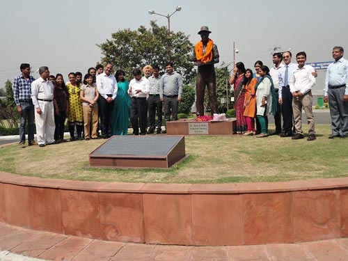 BISA and CIMMYT staff pay tribute to Norman Borlaug, in the shadow of his statue and accomplishments. Photo: Meenakshi Chandiramani