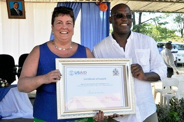 Ms, Virginia Palmer (left), US Ambassador to Malawi, and Dr Peter Setimela (CIMMYT–SARO), with the Feed the Future Malawi Improved Seed Systems and Technologies Project certificate of launch. Malawi heavily relies on agriculture for economic growth, with 80 percent of the country's population engaged fulltime in agriculture.