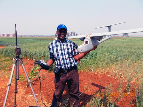 Charles Mutimaamba, Chief Research Officer and Maize Breeder at the CBI, pauses for a photo with the Skywalker in a field. Photo: Thokozile Ndhlela
