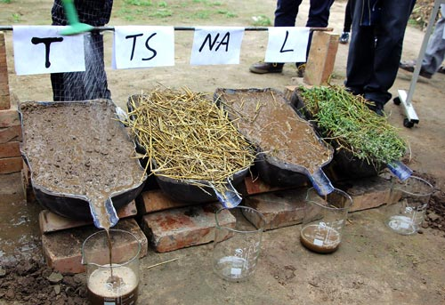 Runoff in action during the rainfall simulation on tilled soil (T), tilled soil with straw cover (TS), non-agricultural soil (NA) and recently mowed lucern (L). Photo: Stephen Yeboah/GAU