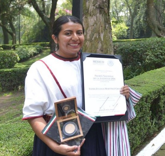 Tania Martínez, PhD fellow with CIMMYT, holding her national youth award for outstanding performance in academic achievement. Photo courtesy of Tania Martínez.