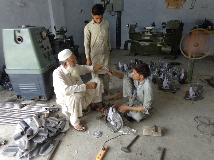 Ameer Sani, a local manufacturer, produces push row planters in his workshop in Mardan. Photo: CIMMYT