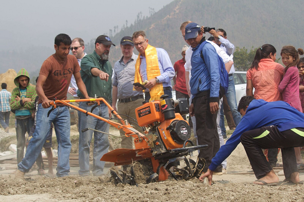 CIMMYT Director General Martin Kropff, observes a mini-tiller in operation during his visit in March this year to Nuwakot, one of the districts benefitting from the Earthquake Recovery Support Program in Nepal. Photo: A. Rai/CIMMYT
