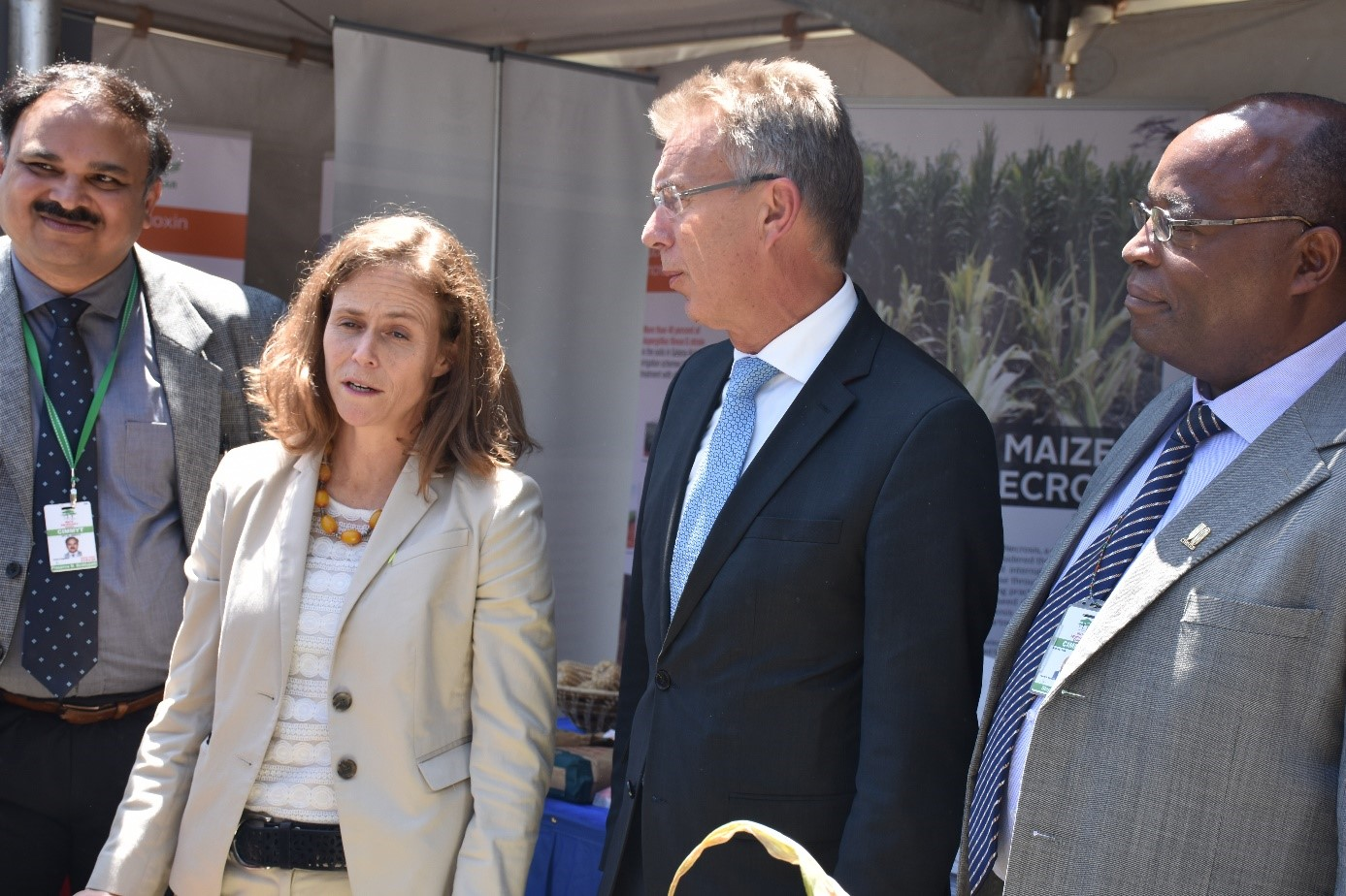 B.M. Prasanna, Martin Kropff and Stephen Mugo brief Beth Dunford, assistant to the administrator of USAID's Bureau for Food Security, on CIMMYT's work at a KALRO/USAID event during AGRF. Photo: B. Wawa/CIMMYT