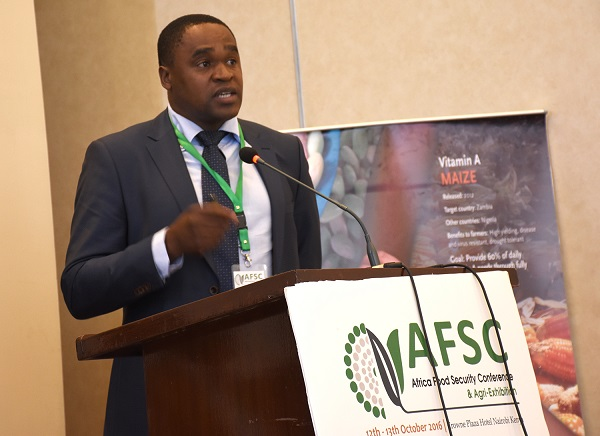 Rodney Lunduka speaking at the AFSC. Photo: K. Kaimenyi/CIMMYT