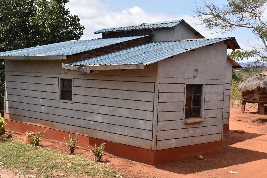A rear view of Kivanga's new home, built from the income generated using improved maize varieties.