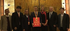 CIMMYT Director General holds the Chinese International Science and Technology Cooperation Award for collaborative work leading to improved scientist training, maize and wheat production.