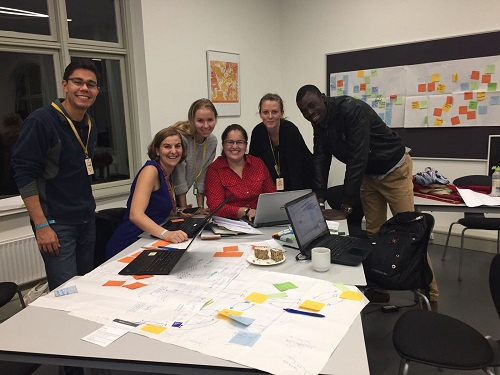 Daniela Vega (center in red) and team working on sustainable supply chains in the fashion industry at UNLEASH. Photo courtesy of D. Vega/CIMMYT