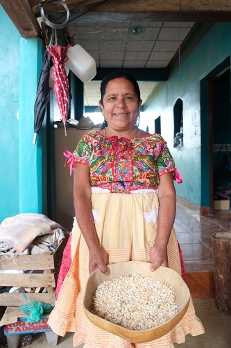 Felipa Martinez shows off some of her family's maize from last year's harvest. Photo: Matthew O'Leary
