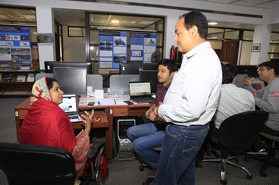 Suraya Parvin (left), Senior Scientific Officer of BARC, discussing with the facilitator in the training. Photo: Jitendra Raj Bajracharya/ICIMOD.